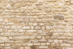 Background texture, wall of pale natural stone Stock Photos