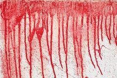 Background texture wall with red blood like paint streaks. royalty free stock photography