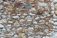 Background texture of wall with several kinds of stones Royalty Free Stock Photography