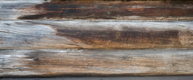 Background texture wall of wooden logs. Weathered pine planks Royalty Free Stock Images