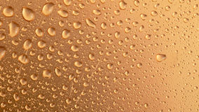 Background texture. Background water drops on a gold surface stock image