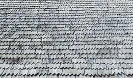 Background texture weathered roof shingles. Background texture full frame wallpaper of gray and white weathered roof shingles stock photo