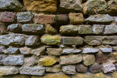 Background texture of a weathered rough stone wall Royalty Free Stock Photo