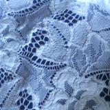 Background texture white lace on dark blue silk. Pretty leaf design. Royalty Free Stock Photos