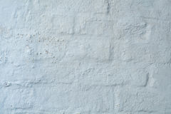 Background texture, white plaster on an old brickwall Stock Photo