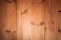 Background texture of wooden wall. Made of pine tree planks with central spot light illumination royalty free stock photography