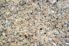 Background, texture - surface of granite slab. Background, texture - yellow spottered granite surface Stock Photography