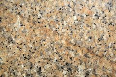 Background, texture - surface of granite slab. Background, texture - yellow spottered granite surface Royalty Free Stock Images