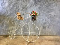 Background textured bicycle show beside cement wall Royalty Free Stock Photos