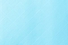 Background of textured embossed turquoise paper stock photo