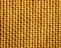 Background textured pattern from fabric of illuminated lamp shade royalty free stock image