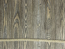 Background of textured pine planks and rope on wooden planks Stock Image