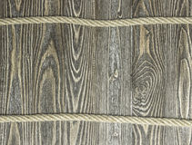 Background of textured pine planks and rope on wooden planks Royalty Free Stock Photo