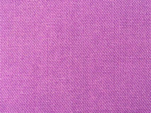 Background of textured purple rough fabric Stock Photography