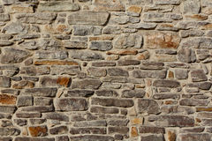 Background textured rustic stone wall. Stone wall rustic texture  background Stock Photography