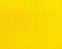 Background  of textured yellow natural textile. The background  of textured yellow natural textile for banner, poster, label, sticker, layout, wallpaper, fabric royalty free stock photos