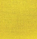 Background  of textured yellow natural textile. The background  of textured yellow natural textile for banner, poster, label, sticker, layout, wallpaper, fabric stock photo