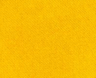 Background  of textured yellow natural textile. The background  of textured yellow natural textile for text, banner, poster, layout, wallpaper royalty free stock photography