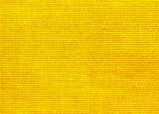 Background  of textured yellow natural textile. The background  of textured yellow natural textile for text, banner, poster, layout, wallpaper stock images
