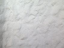Background and textures. Of a whitewashed stone wall of a mountain house Stock Image