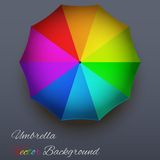 Background on a theme of rain. Rainbow umbrella. Royalty Free Stock Photo