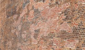 Background of thousands of red bricks of a large wall. Of an ancient medieval impregnable fortress royalty free stock photos