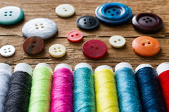 Background from threads and buttons Stock Images