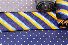 Background of three multi-colored tie. Stock Photography