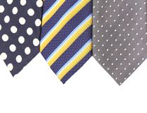 Background of three  multi-colored tie. Stock Photos