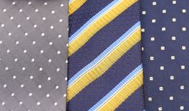 Background of three  multi-colored tie. Royalty Free Stock Photo