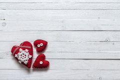 Background with three red hearts on painted wooden planks. Royalty Free Stock Image