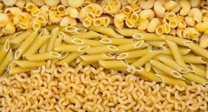 Three types of pasta in three lines Stock Photo