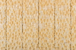 Background from tiled crispbread on table Royalty Free Stock Image