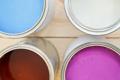Background with tin cans of oil paint royalty free stock photos
