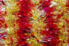 Background of tinsel red and yellow Royalty Free Stock Image