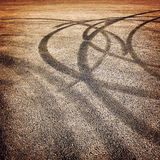 Background with tire tracks on the asphalt - vintage effect. Stock Images