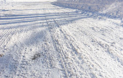 Background of tire tracks in snow Stock Photos