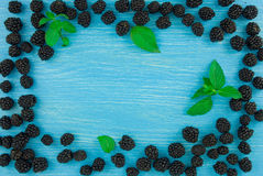 Background for titles with blackberries and wood table Stock Photo