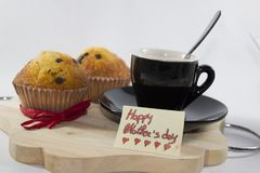 Background to devote to mom, a good morning for her day with cof. Tray with a cup of coffee, two sweets and a birthday card to the mother Royalty Free Stock Images