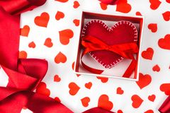 Background to Valentine`s Day or romantic event. heart in the gift box against the background of the hearts. Red ribbon Stock Image