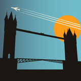 London City Break. Background with Tower Bridge at sunset under a high flying jet Royalty Free Stock Image
