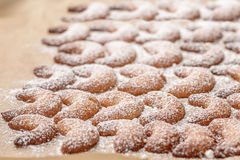 Background of traditional crescent Xmas cookies Royalty Free Stock Photos