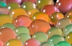 Background with transparent colored beads Royalty Free Stock Photo