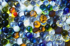Background with transparent colored glass beads. Closeup Stock Image