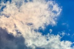 The image of white clouds in the blue sky. royalty free stock photo