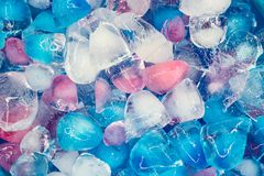 Background with transparent, white, pink and blue ice cubes. Fresh summer pattern. Flat Lay royalty free stock photography