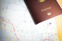 Background of travel with passport and map royalty free stock photography