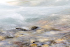 Background of turbulent water in the mountain river Stock Photo