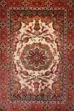 Background Turkish silk carpet. With floral ornament royalty free stock photo