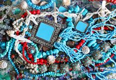 Background - turquoise and pearls. Bright picturesque background with turquoise, pearls, cockleshells and corals Stock Photos